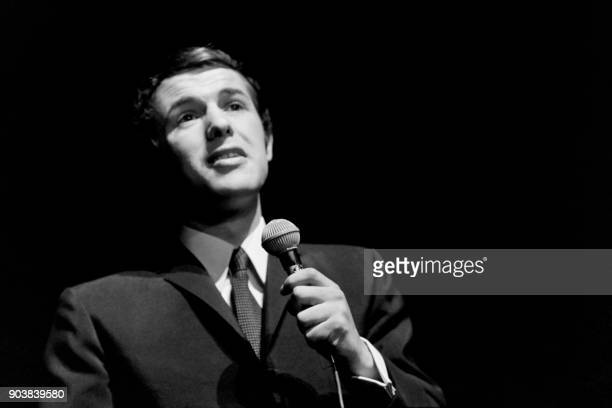 Salvatore Adamo performs on the stage of the Olympia music Hall on December 28 1966 in Paris / AFP PHOTO /