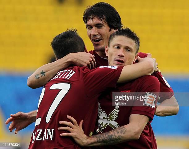 Salvatore Bocchetti Aleksei Medvedev and Cesar Navas of FC Rubin Kazan celebrate after scoring a goal during the Russian Football League Championship...