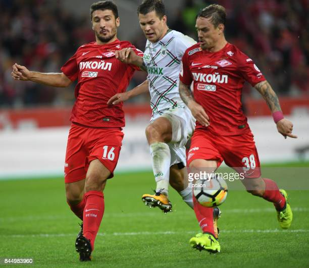 Salvatore Bocchetti and Andrey Yeshchenko FC Spartak Moscow vies for the ball with Maksim Kanunnikov of FC Rubin Kazan during the Russian Premier...