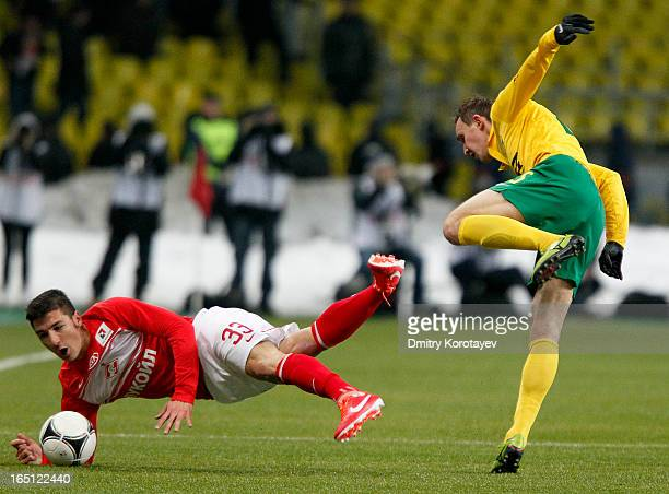 Salvatore Bocchetti of FC Spartak Moscow battles for the ball with Aleksei Kozlov of FC Kuban Krasnodar during the Russian Premier League match...