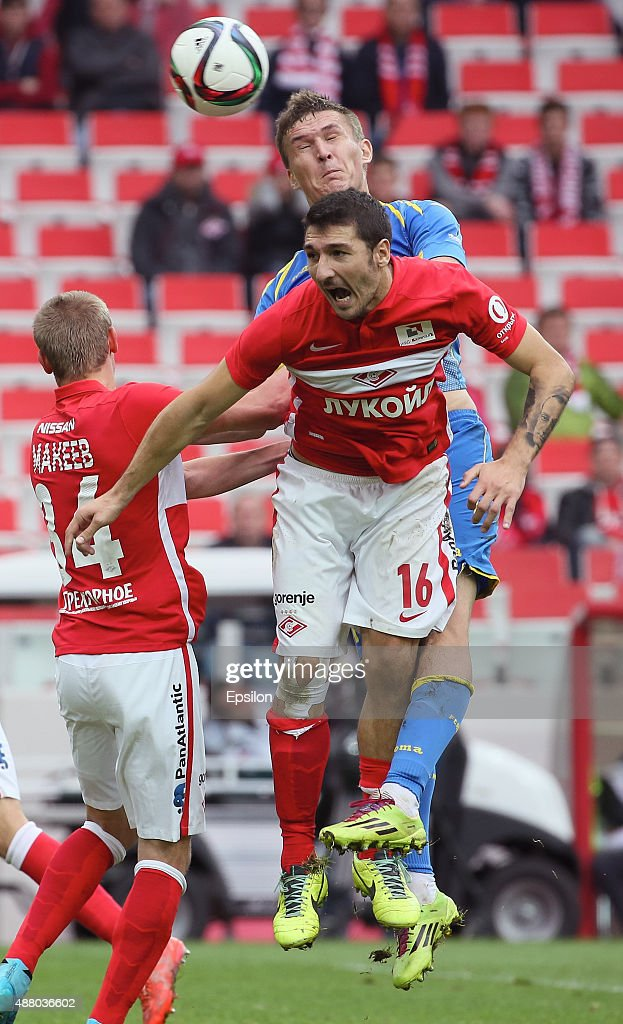 Salvatore Bocchetti of FC Spartak Moscow challenged by Aleksandr Bukharov of FC Rostov Rostov-on-Don during the Russian Premier League match between FC Spartak Moscow v FC Rostov Rostov on Don at the Arena Otkritie stadium on September 13, 2015 in Moscow, Russia.