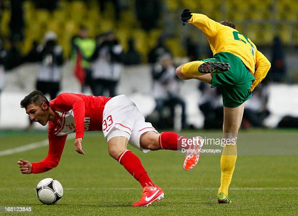 Salvatore Bocchetti of FC Spartak Moscow competes for the ball with Aleksei Kozlov of FC Kuban Krasnodar during the Russian Premier League match...