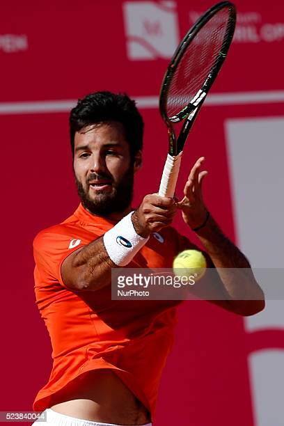 Salvatore Caruso from Italy returns a ball to Andrea Arnaboldi from Italy during their Millennium Estoril Open ATP Singles qualifying 2nd round...