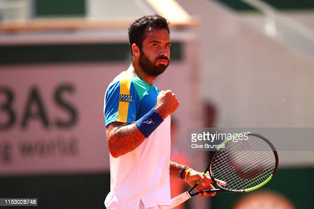 Salvatore Caruso of Italy celebrates during his mens singles third round match against Novak Djokovic of Serbia during Day seven of the 2019 French...