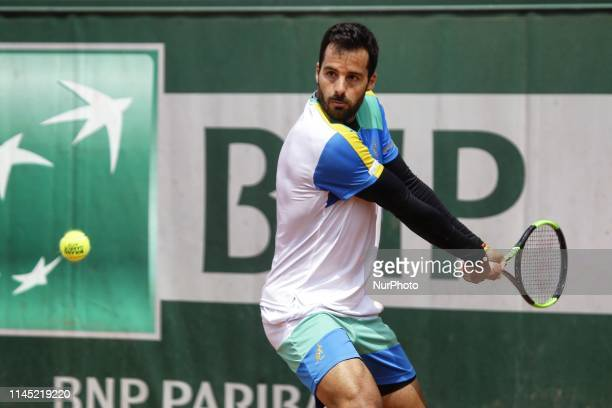 Salvatore Caruso of Italy hits a return during his men's singles against Norbert Gombos of Slovakia in the first round of Roland Garros...