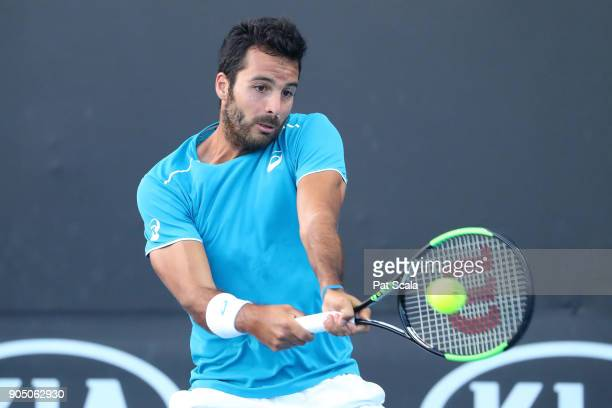 Salvatore Caruso of Italy plays a backhand in his first round match against Malek Jaziri of Tunisia on day one of the 2018 Australian Open at...