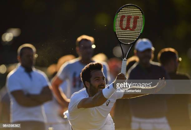 Salvatore Caruso of Italy plays a forehand against Stefano Napolitano of Italy during Wimbledon Championships Qualifying Day 2 at The Bank of England...