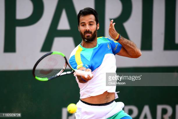Salvatore Caruso of Italy plays a forehand during his mens singles first round match against Jaume Munar of Spain during Day two of the 2019 French...