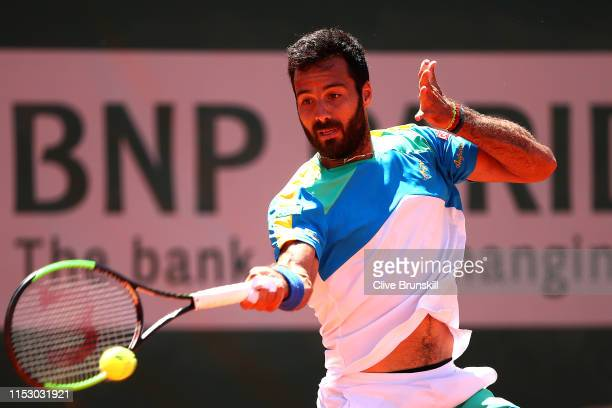 Salvatore Caruso of Italy plays a forehand during his mens singles third round match against Novak Djokovic of Serbia during Day seven of the 2019...