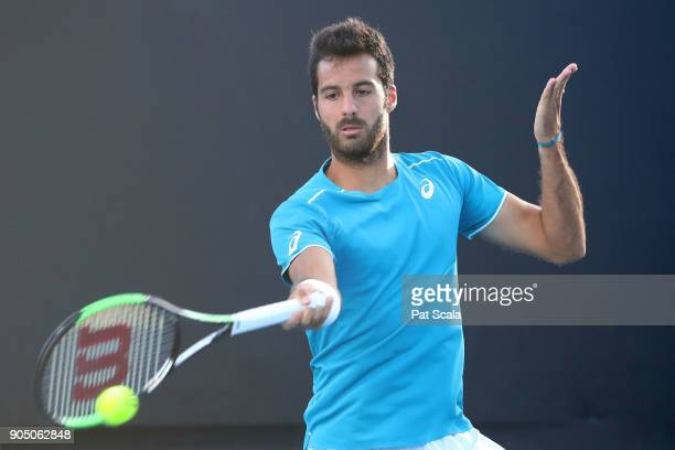 Salvatore Caruso of Italy plays a forehand in his first round match against Malek Jaziri of Tunisia on day one of the 2018 Australian Open at...