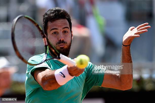 Salvatore Caruso of Italy plays a forehand in his match against Nick Kyrgios of Australia on Day Two of The Internazionali BNL d'Italia 2016 on May...