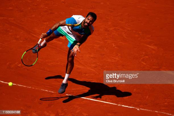 Salvatore Caruso of Italy serves during his mens singles third round match against Novak Djokovic of Serbia during Day seven of the 2019 French Open...