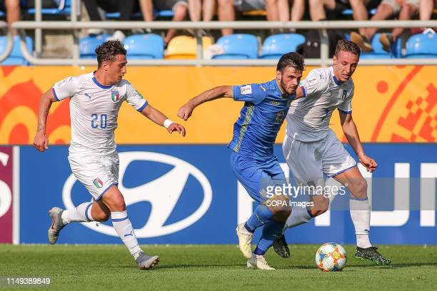 Salvatore Esposito, Davide Frattesi of Italy and Serhii Buletsa of Ukraine are seen in action during the FIFA U-20 World Cup match between Ukraine...