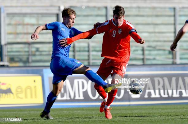 Salvatore Esposito of Italy U19 competes for the ball with Dusan Vlahovic of Serbia U19 during the UEFA Elite Round match between Italy U19 and...