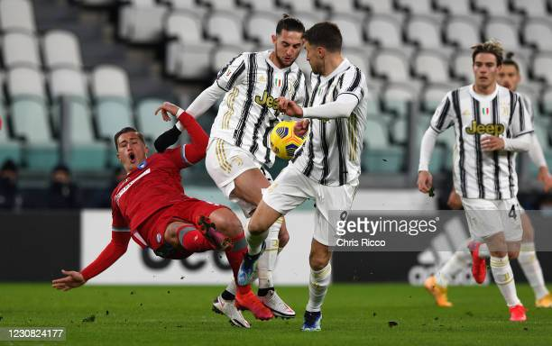 Salvatore Esposito of SPAL challenged by Adrien Rabiot of Juventus during the Coppa Italia match between Juventus and SPAL at Allianz Stadium on...