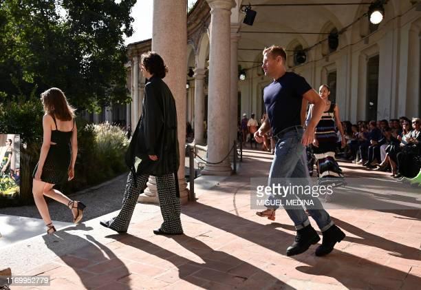 Salvatore Ferragamo's British designer and creative director Paul Andrew runs next to models after the Salvatore Ferragamo's Women's Spring Summer...