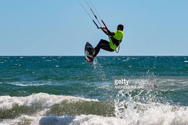 Salvatore Flaccovio co-manager of the Tsunami Kitesurf school in Ladispoli, enjoys kitesurfing on May 7, 2020 in the Tyrrhenian Sea in Ladispoli, 40...
