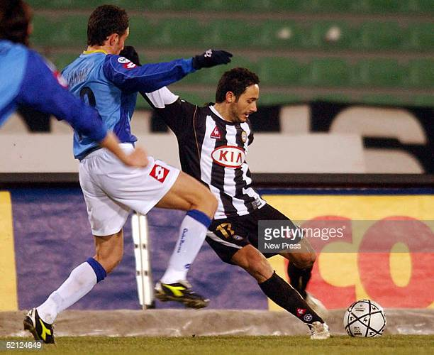 Salvatore Lanna of ChievoVerona struggles for the ball with David Di Michele of Udinese during their match at the Friuli stadium February 2, 2005 in...