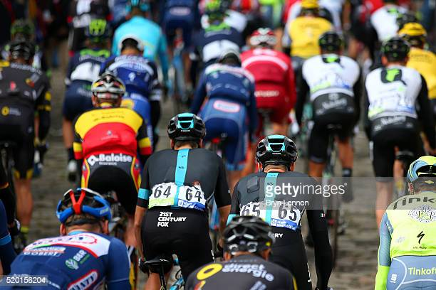 Salvatore Puccio of Italy and Team Sky and Gianni Moscon of Italy and Team Sky leave the Place Charles de Gaulle with the other riders at the start...