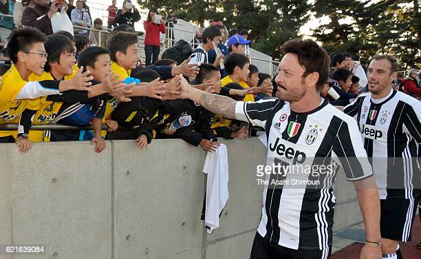 Salvatore Schillaci of Juventus Legend high fives with fans after the 2016 Juventus Legend Charity Match at Shota Shoyu Stadium Gunma on November 5...