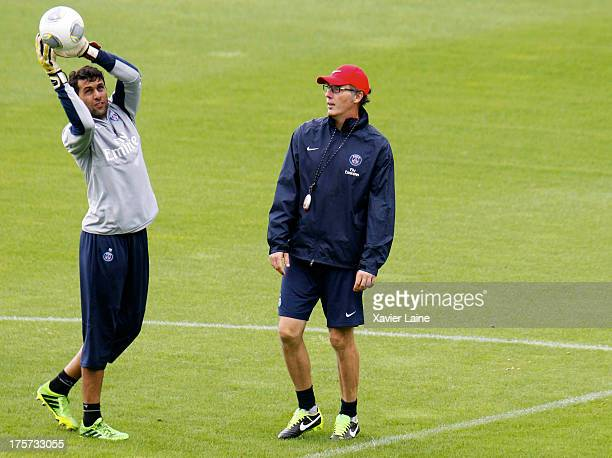 Salvatore Sirigu and head coach Laurent Blanc of Paris SaintGermain during a training session at Clairefontaine training center on August 07 2013 in...