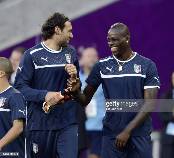 Salvatore Sirigu and Mario Balotelli of Italy during a UEFA EURO 2012 training session at the Municipal Stadium on June 17 2012 in Poznan Poland