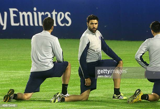 Salvatore Sirigu of PSG stretches during the first practice of the Paris SaintGermain Training Camp the Qatar Winter Tour held at the Aspire Academy...
