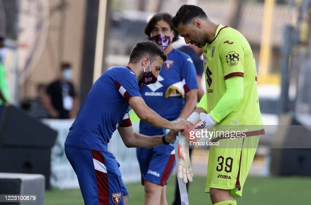 Salvatore Sirigu of Torino adjusts his gloves during the Serie A match between Cagliari Calcio and Torino FC at Sardegna Arena on June 27 2020 in...
