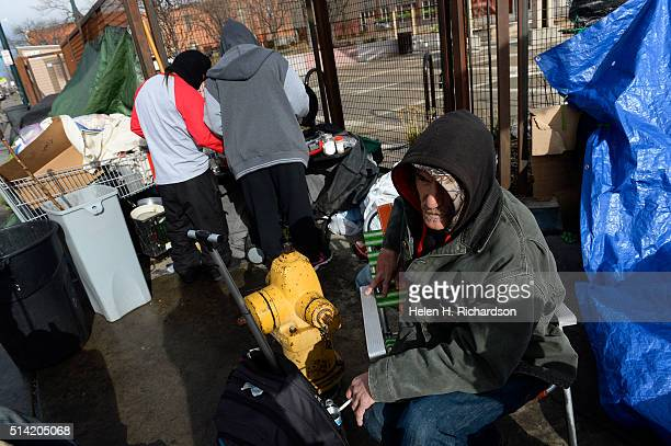 Salvatore who gave only his first name sits on a corner along Park Ave West and Lawrence street in Denver Colorado on March 7 2016 in Denver Colorado...