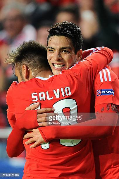 Salvio and Raul Jimenez of SL Benfica celebrate the first goal against FC Bayern Muenchen during the UEFA Champions league Quarter Final Second Leg...