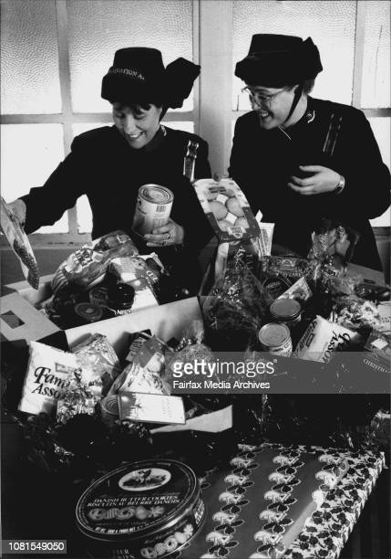 Salvo pack up Christmas Hampers for the needingTimbrelists Lynne Graham amp Alison WarrySalvation Army members Lynne Graham and Alison Warry help...