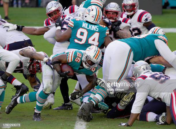 Salvon Ahmed of the Miami Dolphins scores a touchdown against the New England Patriots during the third quarter in the game at Hard Rock Stadium on...