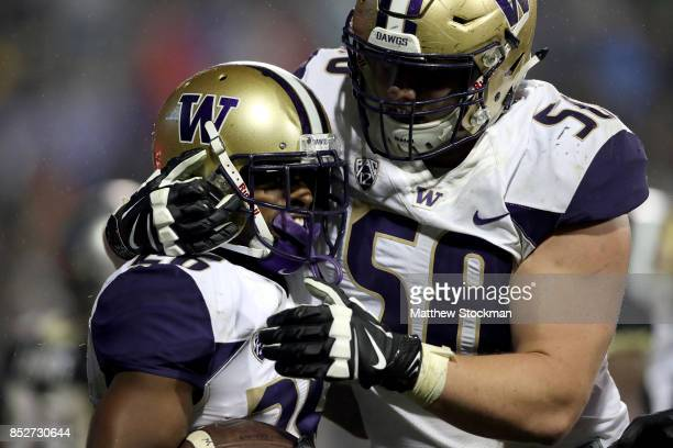 Salvon Ahmed of the Washington Huskies celebrates with Kaleb McGary after scoring a touchdown against against the Colorado Buffaloes at Folsom Field...