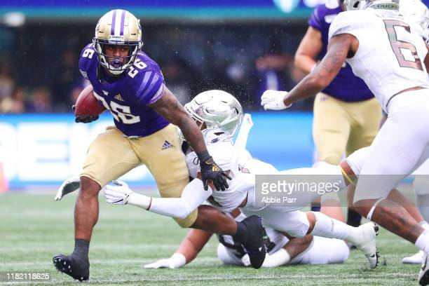 Salvon Ahmed of the Washington Huskies is tackled by Nick Pickett of the Oregon Ducks in the first quarter during their game at Husky Stadium on...