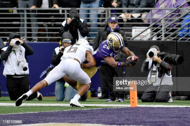 Salvon Ahmed of the Washington Huskies scores on a 9 yard run during the first quarter game against the Oregon Ducks at Husky Stadium on October 19,...