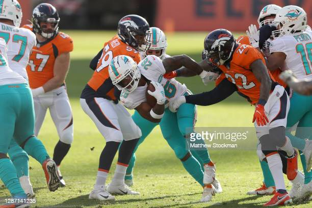 Salvon Ahmed the Miami Dolphins carries the ball during the first quarter against the Denver Broncos at Empower Field At Mile High on November 22...