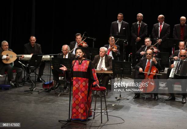 Salwa alAas a 74yearold Jordanian singer of Palestinian origin performs during a concert with the Beit alRowwad ensemble at Hussein Cultural Center...