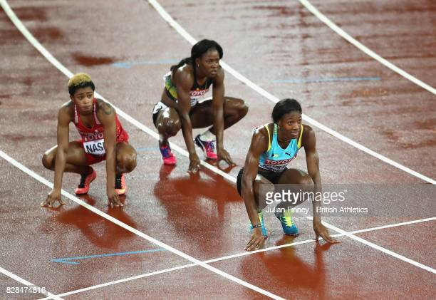 Salwa Eid Naser of Bahrain and Shaunae MillerUibo of the Bahamas wait for results after the Women's 400 metres final during day six of the 16th IAAF...