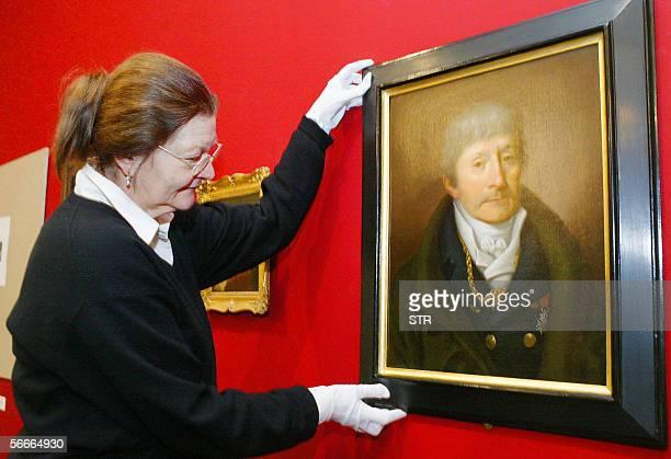 Restorer Stefanie Flinsch places a portrait of bandmaster and Mozart's rival in Vienna Antionio Salieri a portrait by Joseph Willibrord Maehler in...