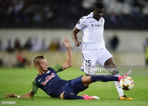 Salzbourg's midfielder from Austria Hannes Wolf vies with Vitoria Guimaraes' midfielder from Ghana Alhassan Wakaso during the Europa League football...