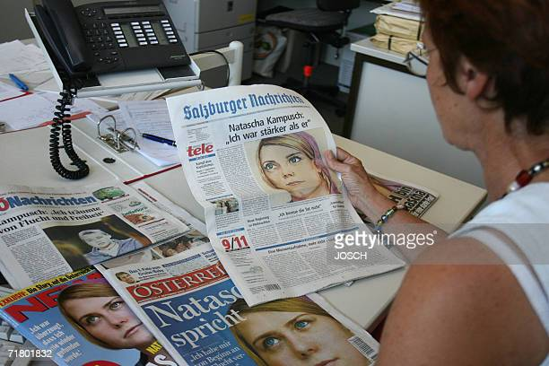 An unidentified woman views the frontpage of the the 'Salzburger Nachrichten' one day after the first interview with Natascha Kampusch in Salzburg 07...