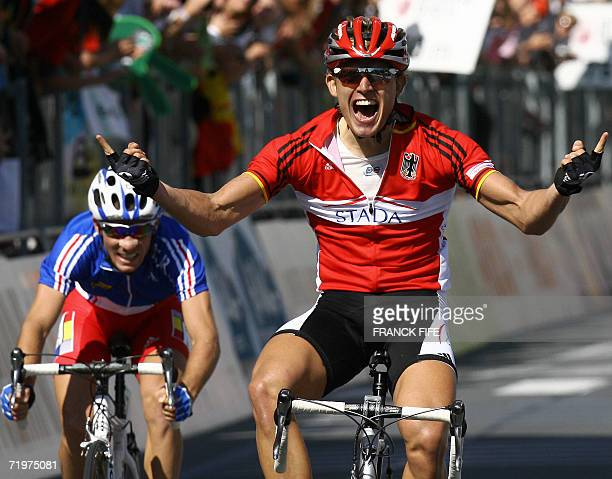 German Gerald Ciolek celebrates as he crosses the finish line of the men's under-23 world road race at the 2006 Cycling world road championships...