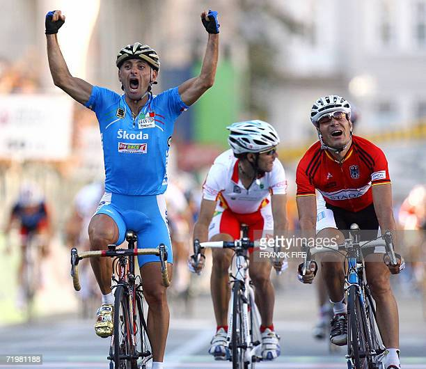 Italian Paolo Bettini celebrates as he crosses the finish line of the men's road cycling crown of the 2006 Cycling World championships followed by...