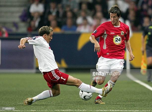 Salzburg's Hungarian defender Laszlo Bodnar vies for the ball with Blackburn Rover's Norwegian midfielder Morten Gamst Pedersen during their UEFA Cup...