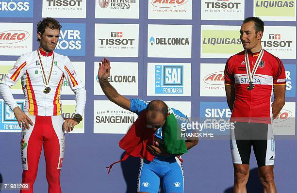 Spain's Alejandro Valverde Italian Paolo Bettini and Germany's Erik Zabel celebrate in the podium after the men's road cycling crown of the 2006...