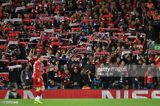Salzburg fans cheer on their team during the UEFA Champions league Group E football match between Liverpool and Salzburg at Anfield in Liverpool...