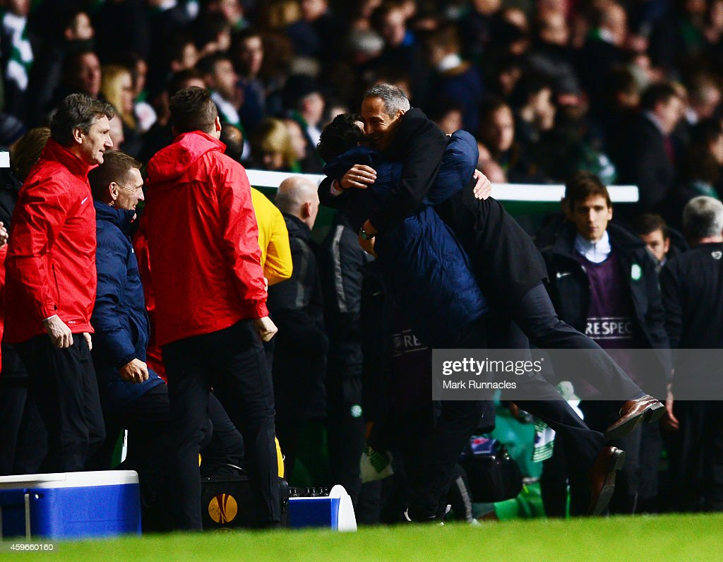 FC Salzburg manger Adolf Hutter celebrates winning the group with the coaching staff during the UEFA Europa League group D match between Celtic FC and FC Salzburg at Celtic Park on November 27, 2014 in Glasgow Scotland.