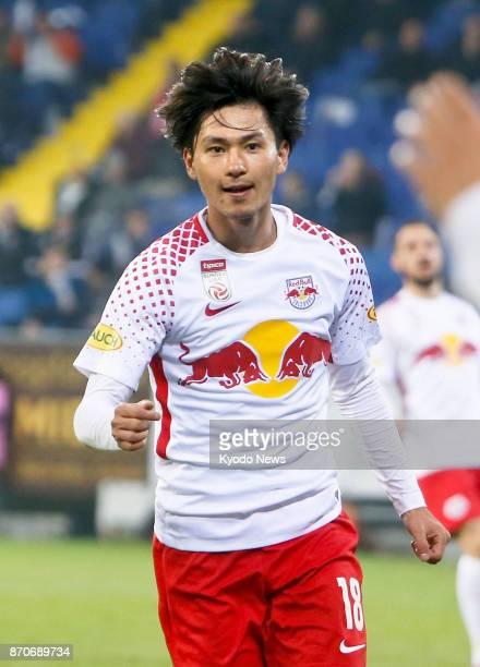Salzburg midfielder Takumi Minamino celebrates the second of his two goals against St Polten in the Austrian first division on Nov 5 2017 ==Kyodo