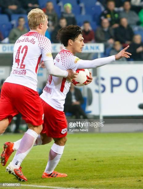 Salzburg midfielder Takumi Minamino celebrates with teammate Xaver Schlager after scoring in the first half against St Polten in Austrian first...