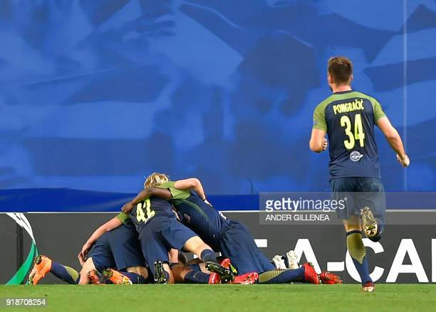 Salzburg players celebrate their second goal during the UEFA Europa League first leg round of 32 football match between Real Sociedad and FC Salzburg...